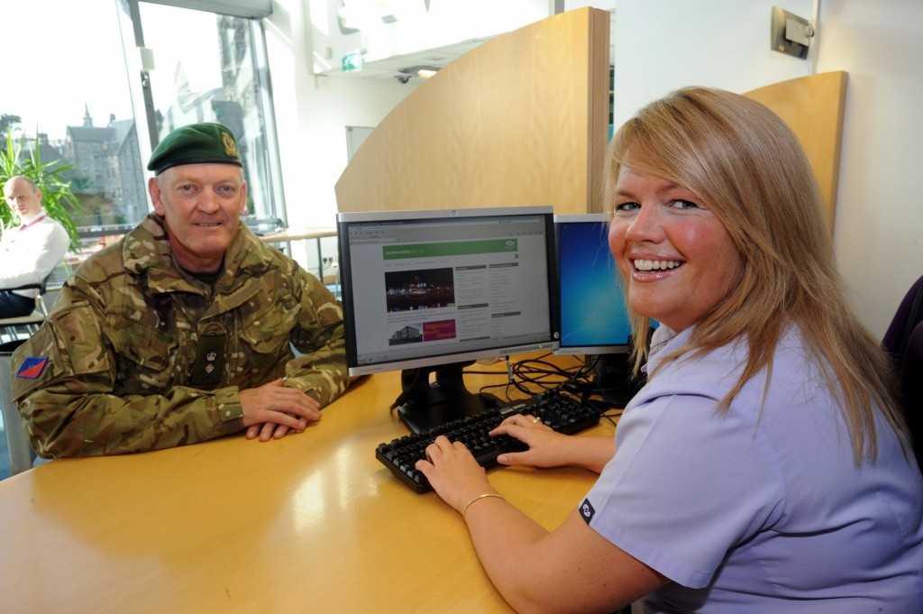 Lt Col Neil Russell with Renfrewshire customer service advisor Stacey Stuart