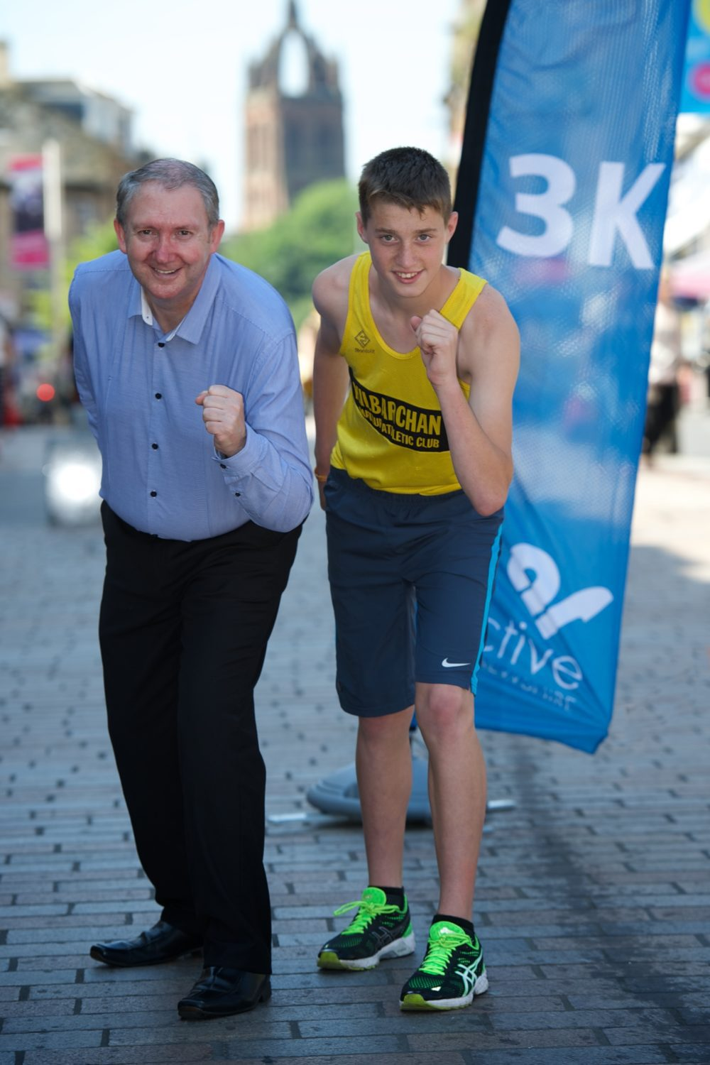 Young athlete Conor Thomson with Cllr Harte