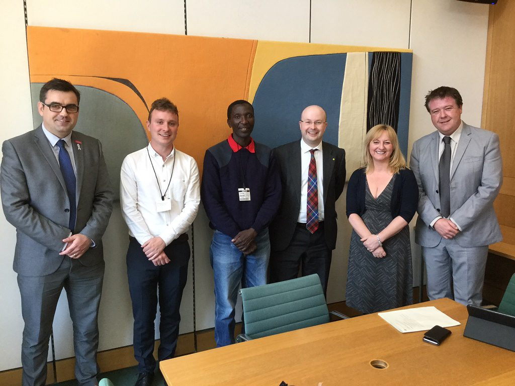 Gavin Newlands MP, Patrick Grady MP, Dr Lisa Cameron MP, Richard Arkless MP with Kenneth Mwakasangula and James Johnstone.