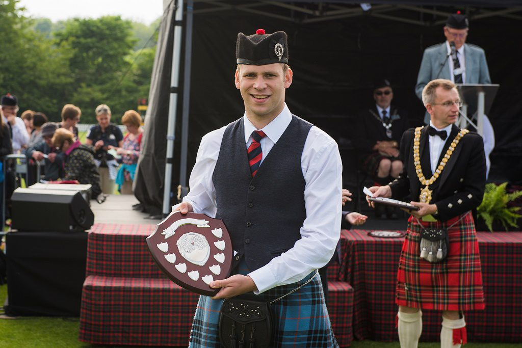 Grade 2  Pipe Major Keith Bowes Jr with the 3rd place trophy .   Pictures by John Shaw