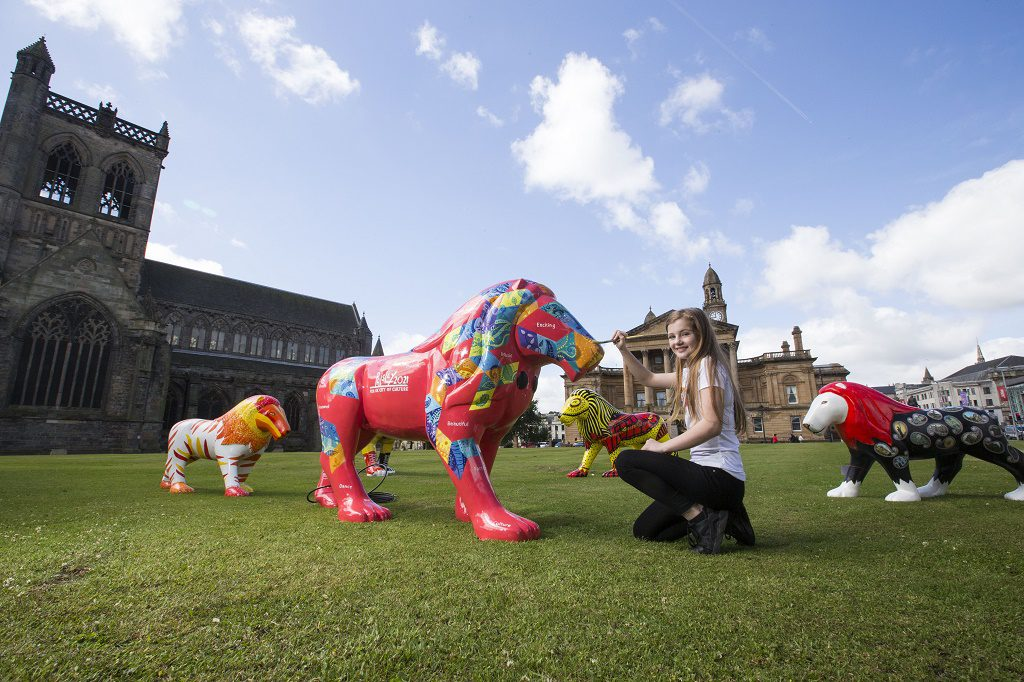 07/07/16.... PAISLEY. colourful painted life-size lion sculptures created as part of the biggest public art project in PaisleyÕs history. The Pride of Paisley Wild in Art Project is taking place as part of the townÕs bid for UK City of Culture 2021 and has seen 25 lions - inspired by popular Paisley Museum exhibit Buddy the Lion Ð created and individually painted by local artists and schools Erin Lafferty,