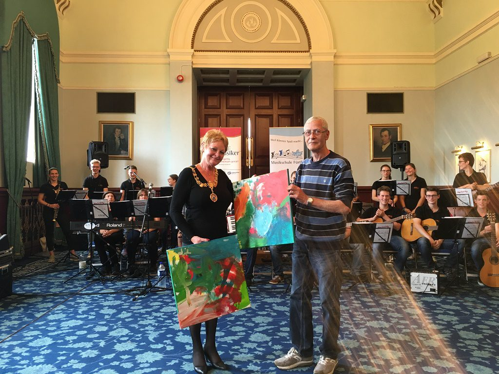 Renfrewshire's Provost Anne Hall with gifts from Alex Hamilton of Fürth Music School.
