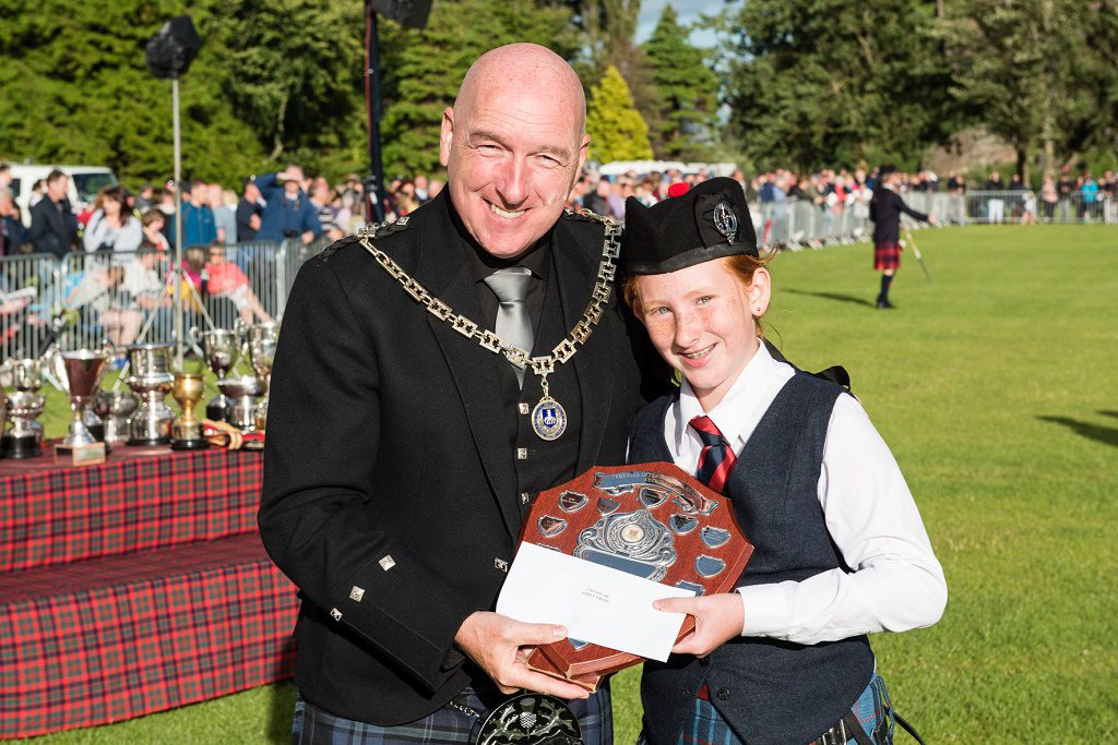 Erica Gill (12) picking up the Grade 4b Championship Shield