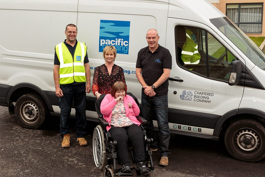 Margaret Hamill and her daughter, Fiona with from left Mariusz Dluzniewski, from Pacific Building and Stephen Donaldson, from Central Flooring