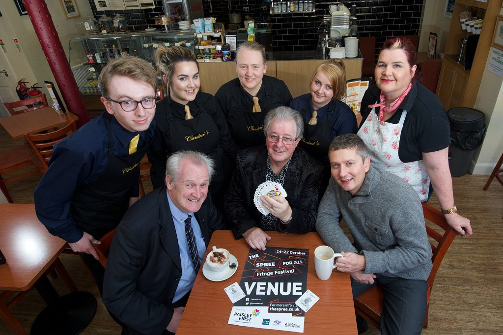 Magicians Tommy Templar and Stevo with staff from Cardosi's espress bar and Ta Ta Bella's tearoom and Andrew Mitchell from Paisley First