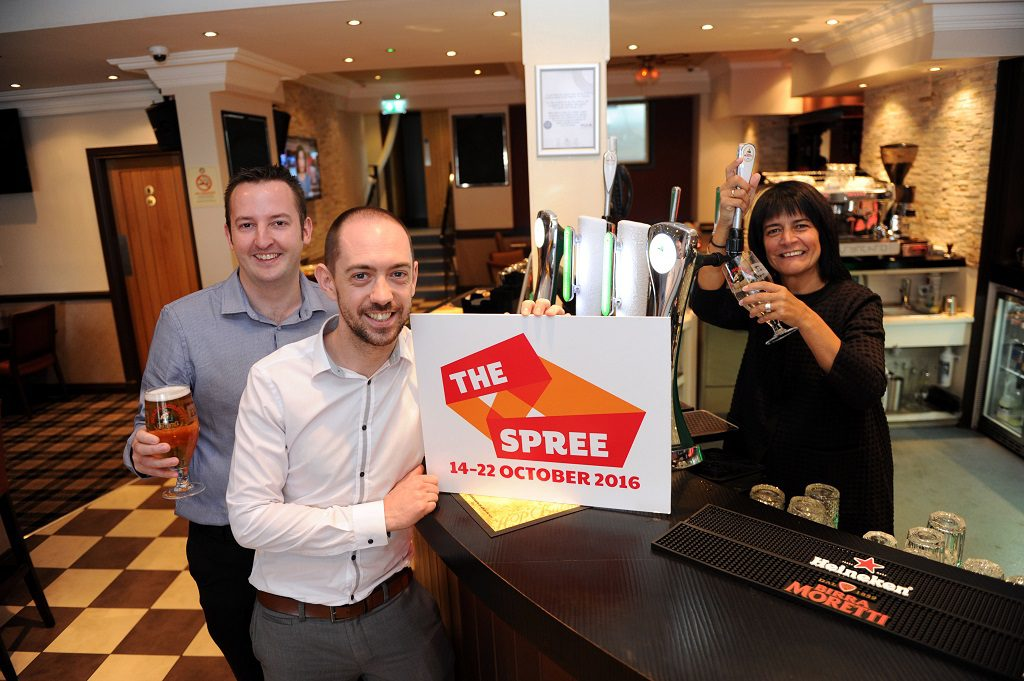 Carol Laula pours a pint for Saporito owners Gary McCaw and Craig Bickett in the new Saporito High Street restaurant