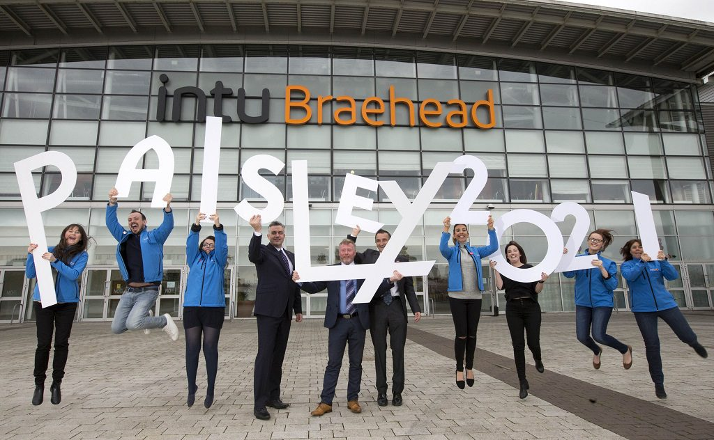 Braehead general manager Gary Turnbull and Councillor Mark Macmillan with mall staff showing their support for Paisley's City of Culture 2021 bid
