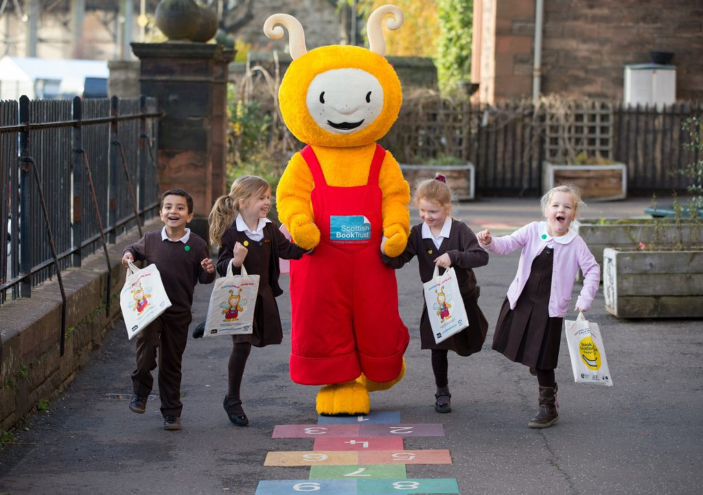 "Every P1 Child To Get Three Free Books During Book Week Scotland Pictured  Bookbug  meets youngsters from Roseburn Primary School in Edinburgh.   As part of Book Week Scotland 2016, the national celebration of reading taking place between 21 and 27 November, Scottish Book Trust will gift three free picture books to every Primary 1 child in Scotland.   The books, all by Scottish authors or illustrators, will be gifted in the Bookbug Primary 1 Family Bag and children will receive this year's shortlisted books for the book Bookbug Picture Book Prize.  The titles include: There's a Bear on My Chair by Ross Collins, Hare and Tortoise by Alison Murray and Shark in the Park on a Windy Day by Nick Sharratt.   Also included in the Bookbug bag will be an activity booklet full of games and fun things to do, along with a voting slip to enable children to declare which of the three picture books is their favourite. Marc Lambert, Chief Executive of Scottish Book Trust, said:   ""The beginning of school is the point at which books start to become associated with learning in a child's mind. The Bookbug Primary 1 Family Bag has been designed to show children how pleasurable and fun reading can be. The intention is to help them to get more out of school and inspire them to seek out and devour more books.""   For more information about Book Week Scotland 2016, visit www.bookweekscotland.com, where you can find information about all the events taking place in your local area, vote for your favourite Scottish book to screen adaptation, take part in a  #ReadingDare and discover a whole host of resources and ideas to help you celebrate and share whatever it is you love to read.   Initiated by the Scottish Government and supported, along with a Readers in Residence programme in libraries, by £200,000 from Creative Scotland, Book Week Scotland will be delivered by Scottish Book Trust. Book Week Scotland in libraries is funded by The Scottish Library and Information Council.   There will be a photocall on Tuesday 15 November at 10.30 -11am, Roseburn Primary (64 Roseburn Street Edinburgh, EH12 5PL) . Please confirm attendance by emailing miriam.morris@scottishbooktrust.com   Photograph by Martin Shields  Tel 07572 457000 www.martinshields.com © Martin Shields"