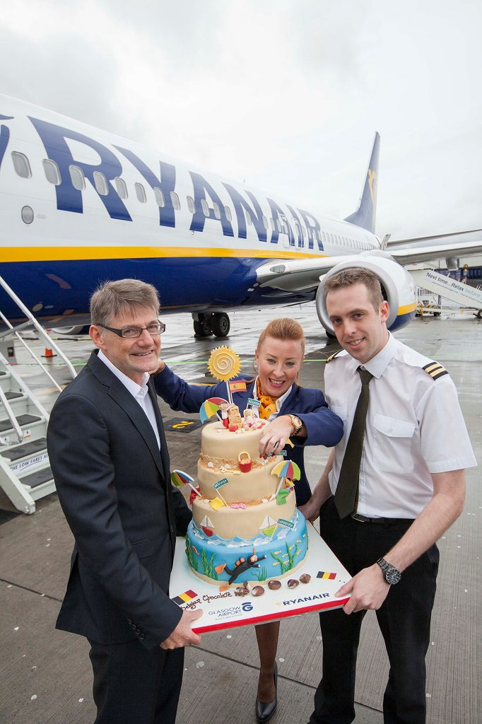 Glasgow Airport's Paul White with Ryanair cabin crew member Lynsey Sloan and first officer Adam Sutton