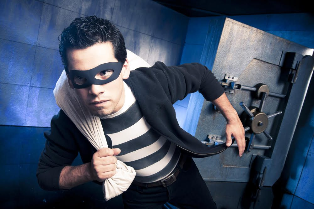 thief running out of a bank vault, low-key photo
