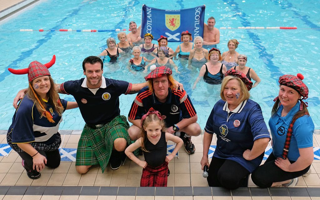 Pool staff, from left Susan McCann, Paul Caruth, Colin Dearing, Carole Doyle and Elaine Carlton with Highland dancer, youngster Hayley Carlton