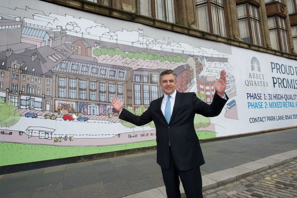 Cllr Macmillan outside Arnotts new hoardings