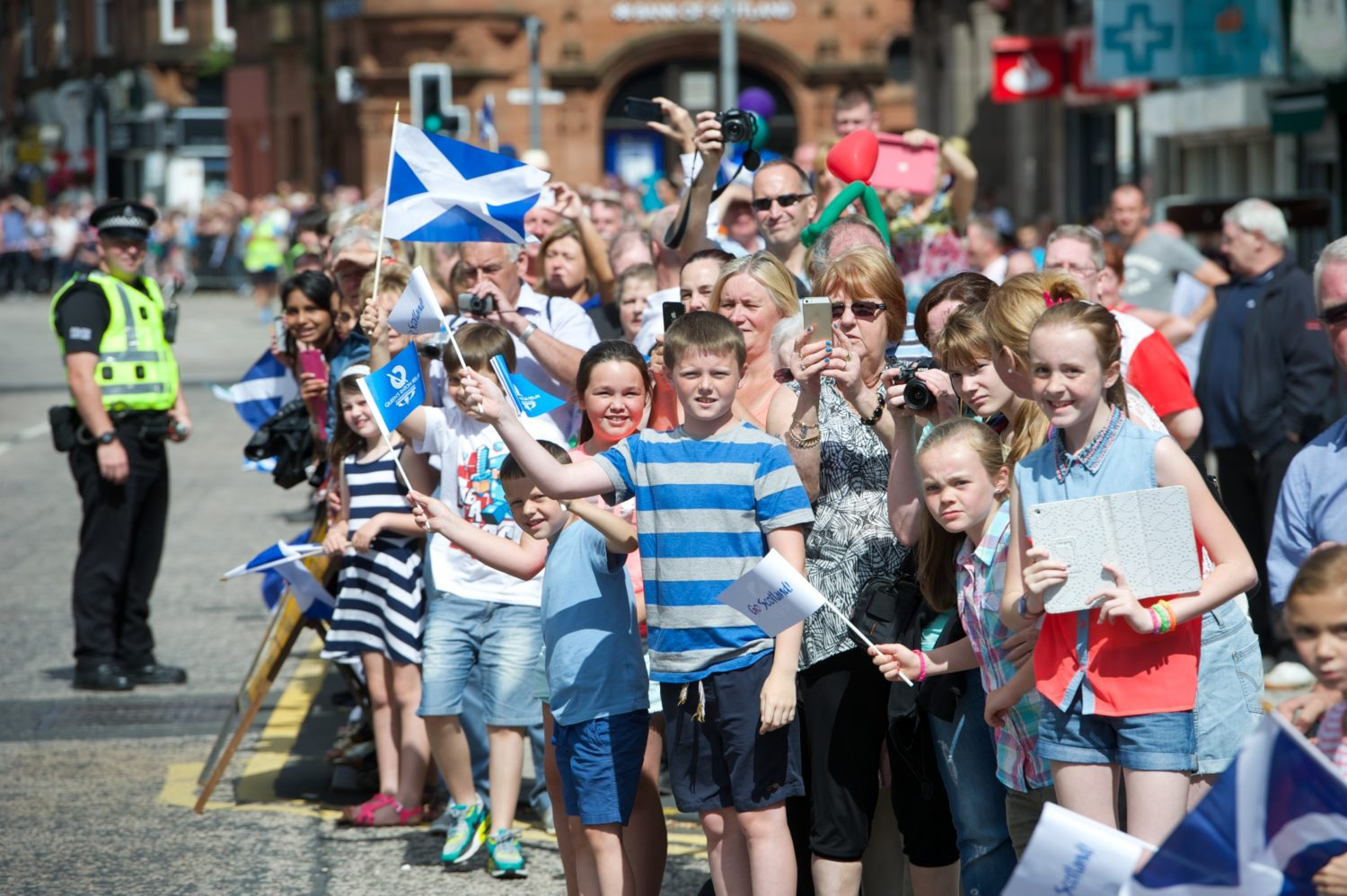 Crowds gather in Renfrew to welcome the baton