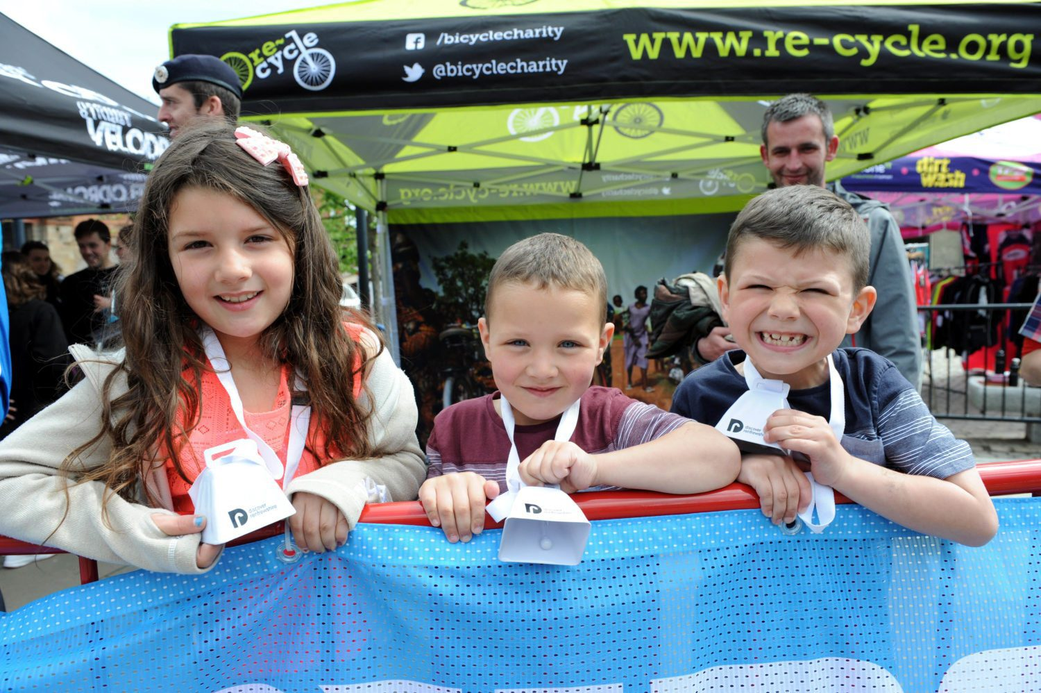 Velodrome 31 crowd ringing cow bells L-R Caitlin 8, Seamus (5) and Ciaran (7) Murney from Johnstone.