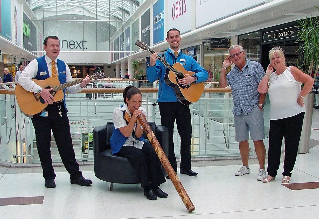 From left, would-be buskers, Willie Carmichael, Donna Smith and Stewart Wonnacott get an audience from shoppers David and Christine Connolly