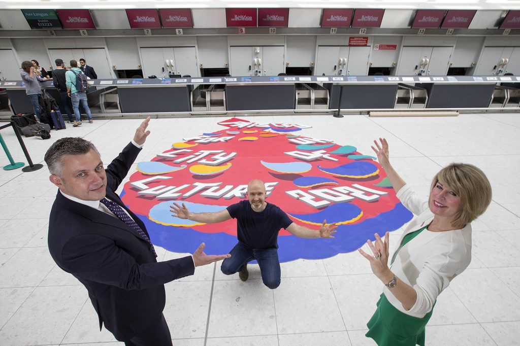 08/06/16.. GLASGOW AIRPORT - GLASGOW  Paisley is bidding for the title as part of ambitious plans to transform the town's future using culture and heritage.  Glasgow Airport is represented on the body which governs the bid and is among the first of several big-name Renfrewshire-based organisations to declare backing for Paisley 2021 over the next few months.  Picture opportunities on the day will include a specially-commissioned piece of Paisley-themed artwork by local artist Duncan Wilson – a trompe l'oeil, which will create a striking 3D 'trick of the eye' within the airport check-in area. Council leader Mark MacMillan and Glasgow airport chief excutive Amanda McMillan