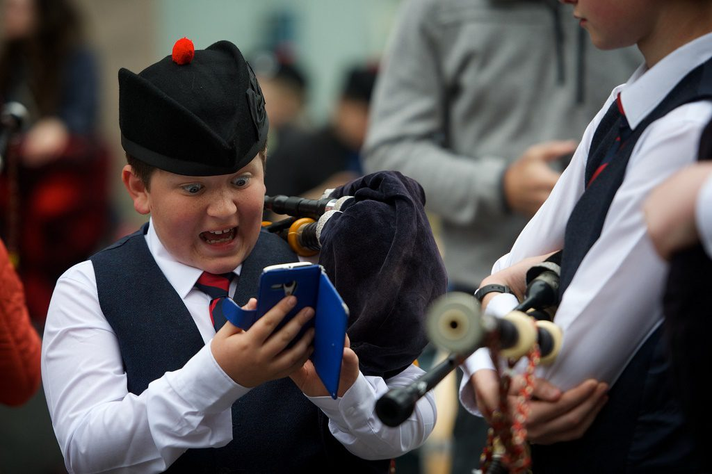 Paisley Piper catches a Pokomon. Ruari Buchan a young piper withe the Johnstone Pipe Band got lucky in Paisley just before performing for the judges at the Paisley Pipe Band Championship. While the others were getting their pipes tuned Ruari had a quick check and bagged himself a Pokomon. Pic by Kieran Chambers