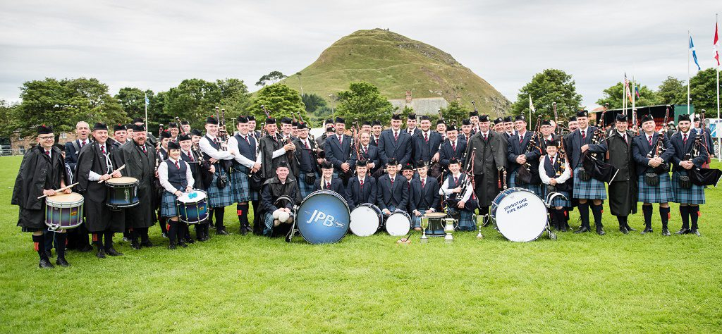 the combined bands with the three trophies won on Saturday