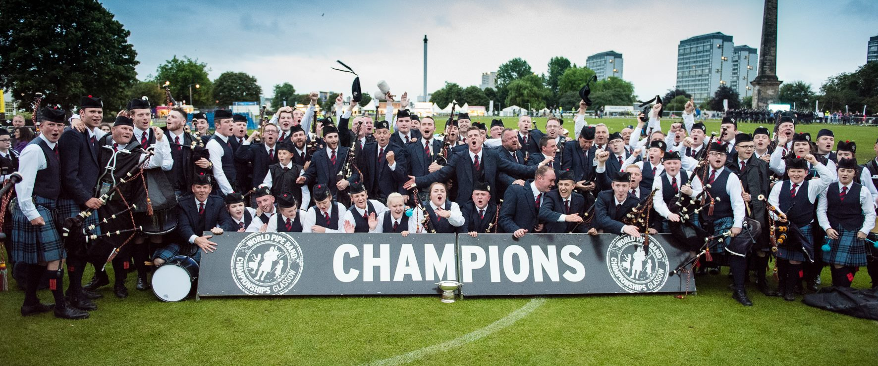 The combined bands celebrating their World Championship wins in August Pictures by John Shaw