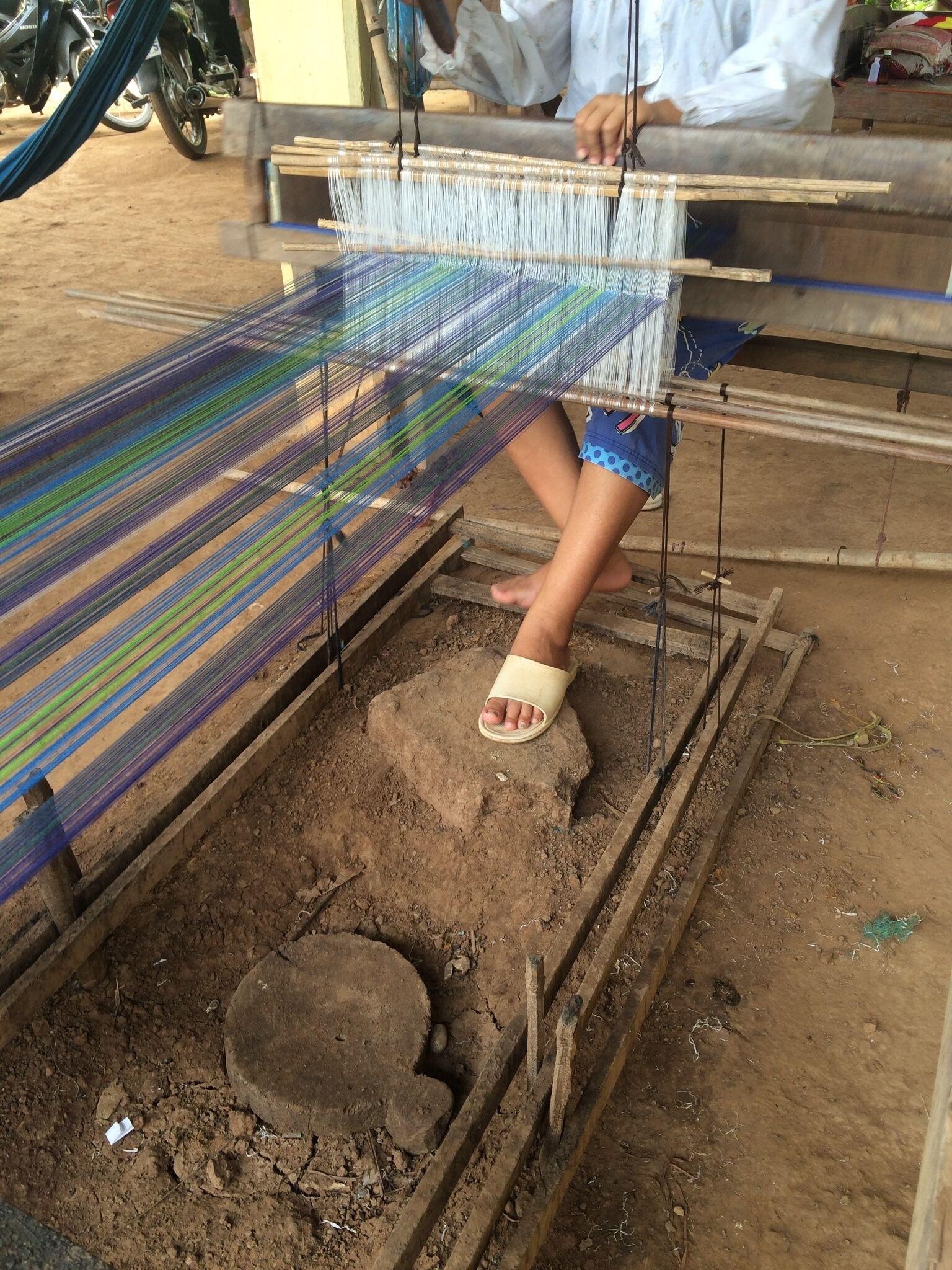 Artisan in Cambodia weaving the fair trade tartan