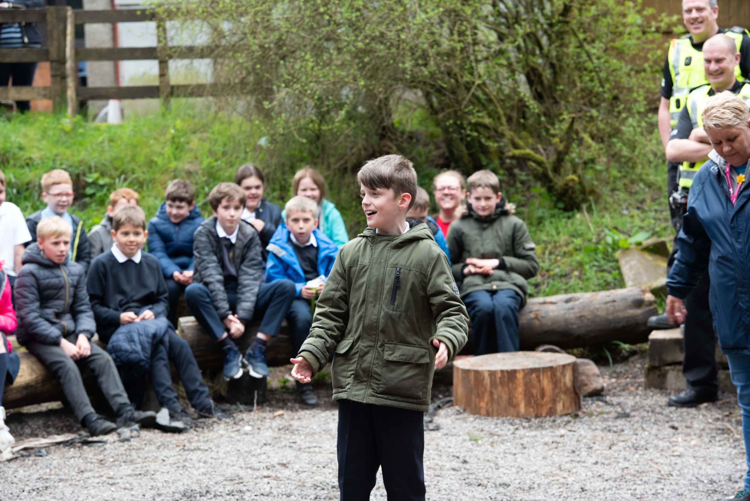 A pupil leads the group with a song