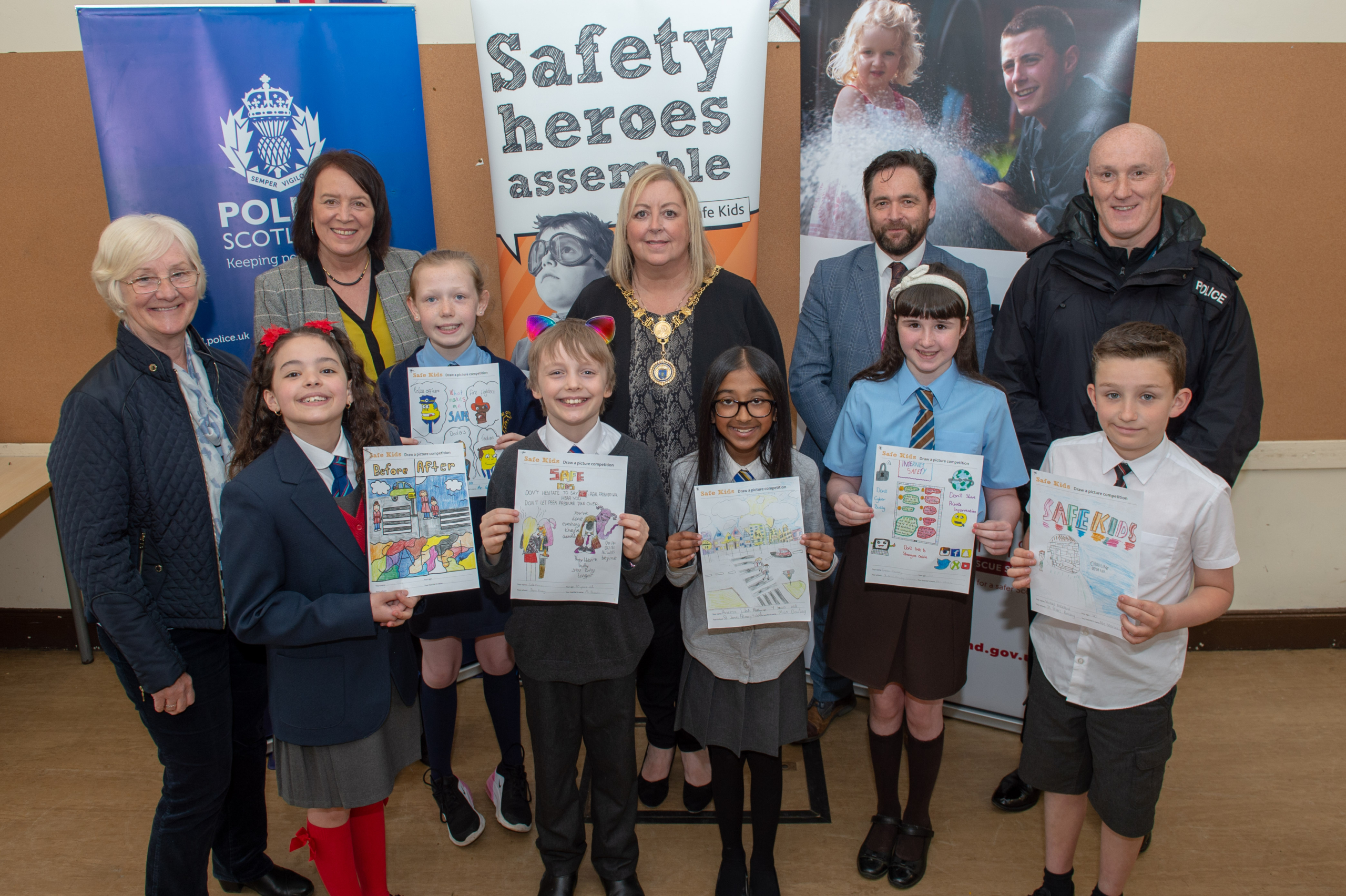Safe Kids poster winners with the partners involved