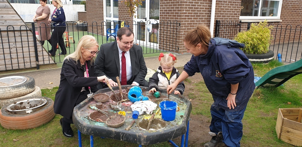 Laura, Convener, Lily and Anne Marie playing with mud - St Margaret's ELCC Johnstone