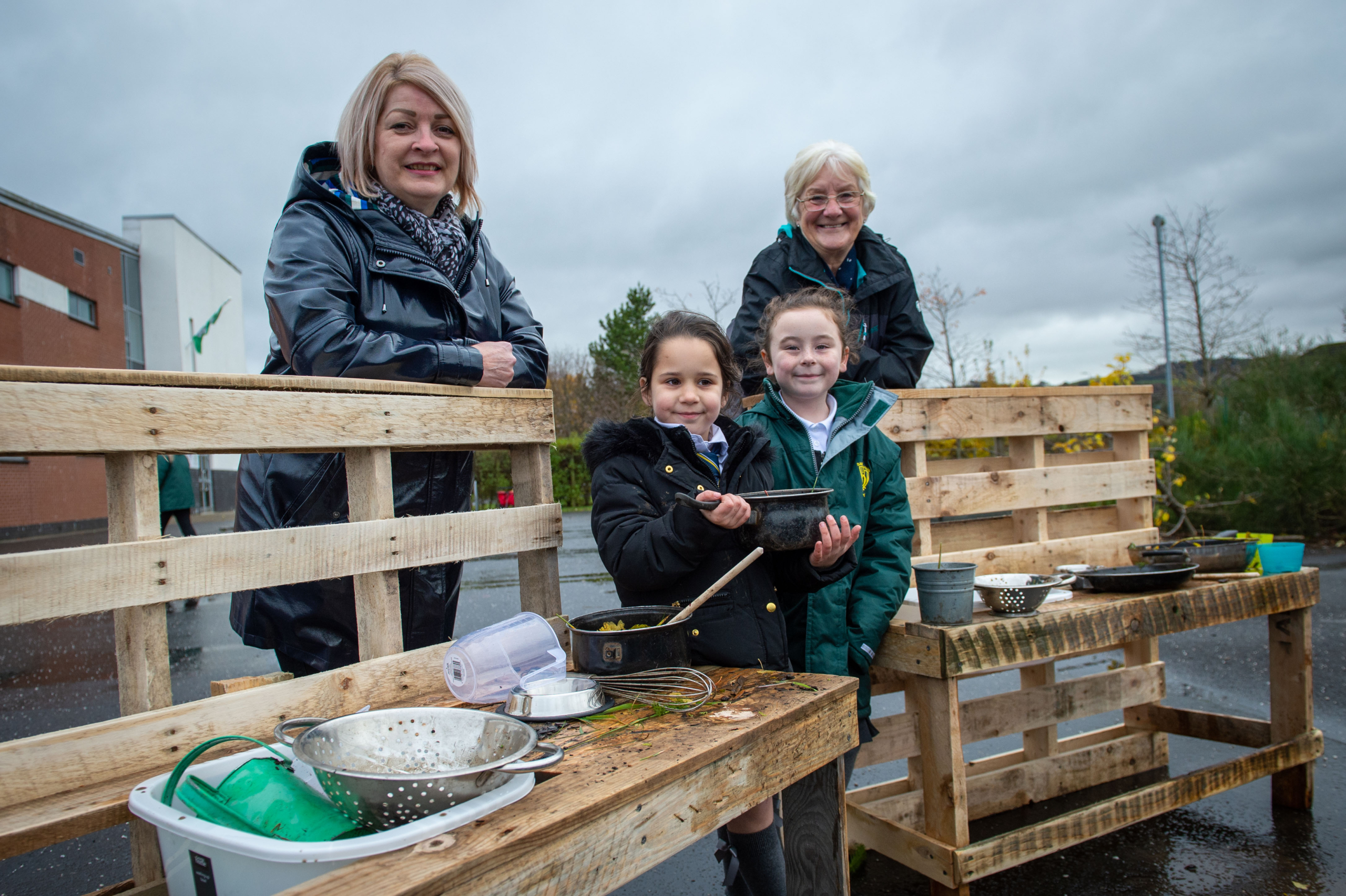 Gail Scoular, Cllr Cathy McEwan, and a Cochrane Castle Primary & St David's Primary pupil