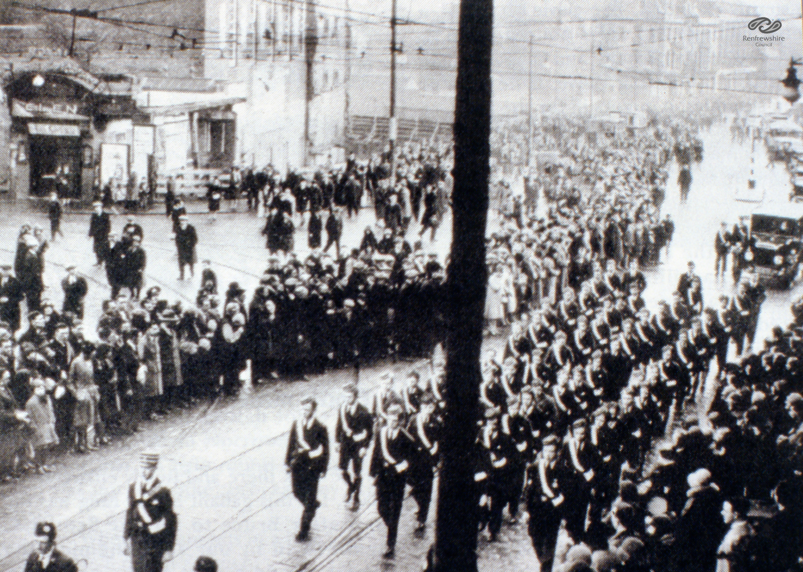Boys Brigade march past picture house at funeral