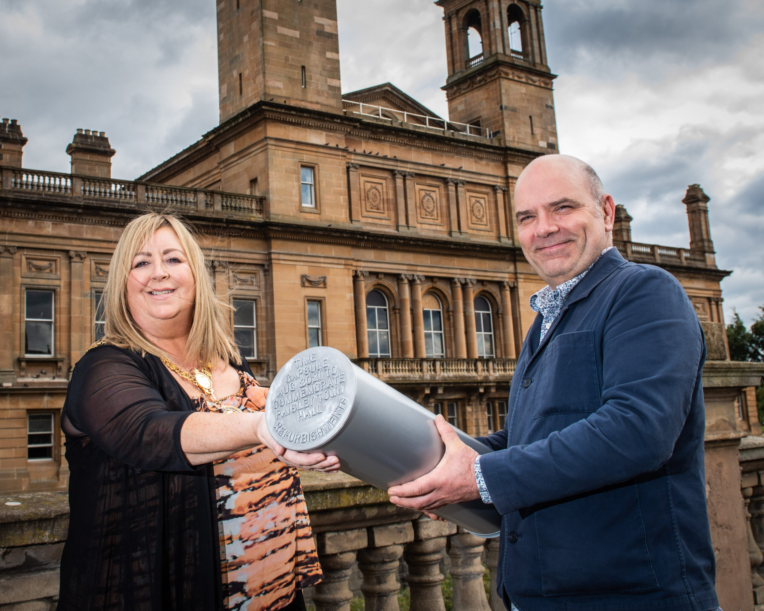 Provost Lorraine Cameron and artist Kevin Cameron with the time capsule